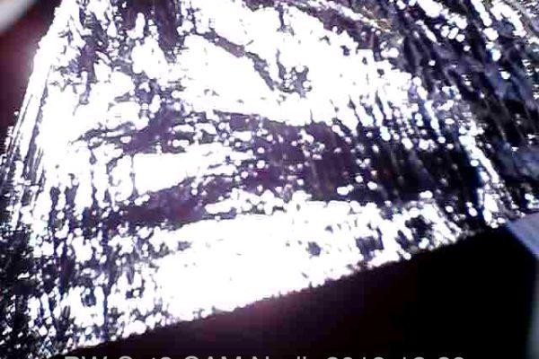 Jedno z pierwszych zdjęć odebranych po otwarciu żagla. Zdjęcie przedstawia jedną z ćwiartek żagla.